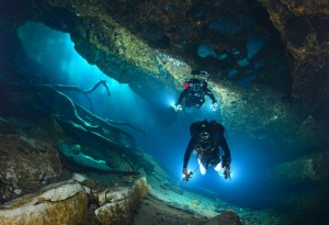Cave Divers Entering the Aquifer