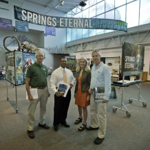 The Springs Eternal Project's first exhibition tour for policy makers. Dr. Bob Knight, Representative Clovis Watson, Jr., Springs Eternal Project Co-Directors Lesley Gamble and John Moran